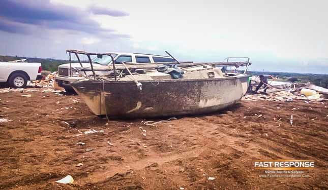 abandoned sailboat hauled to dump
