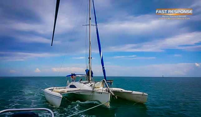 trimarran under tow after salvage