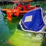 Marine salvage of boat sunk at dock.